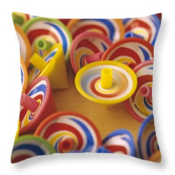 Spinning Tops Throw Pillow by Jim Corwin