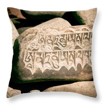 writing on the Tibetan language and Sanskrit at stone Throw Pillow by Raimond Klavins