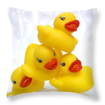 Yelow Ducks Throw Pillow by Bernard Jaubert