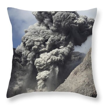 Ash Cloud Rises From Crater Of Batu Throw Pillow by Richard Roscoe