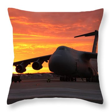A C-5 Galaxy Sits On The Flightline Throw Pillow