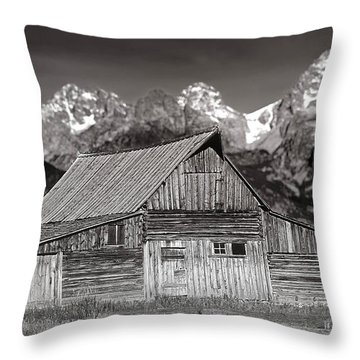 Throw Pillow featuring the photograph Barn And Tetons by Jerry Fornarotto