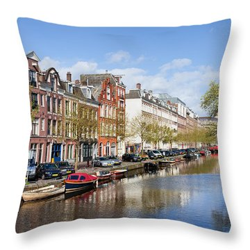 Boats On Amsterdam Canal Throw Pillow