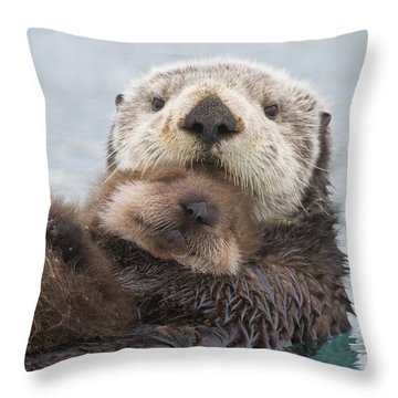 Female Sea Otter Holding Newborn Pup Throw Pillow