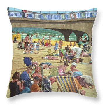 people on Bournemouth beach Throw Pillow