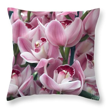 Pink Orchids Throw Pillow by Debbie Hart