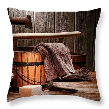 The Old Laundry Throw Pillow by Olivier Le Queinec