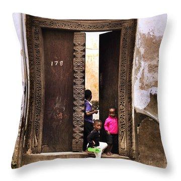 Throw Pillow featuring the photograph Kids Playing Zanzibar Unguja Doorway by Amyn Nasser