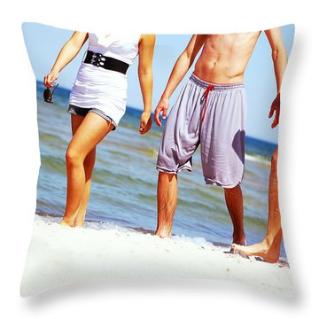 Young Friends On The Summer Beach Throw Pillow by Michal Bednarek
