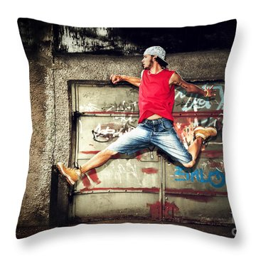 Young Man Jumping On Grunge Wall Throw Pillow by Michal Bednarek