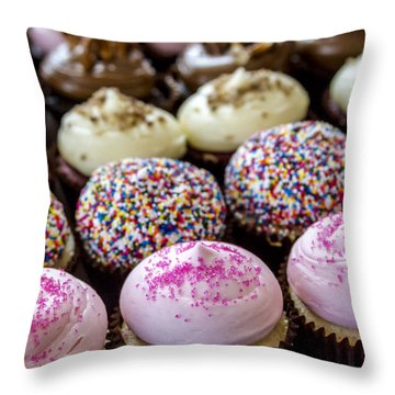Assorted Flavors Of Cupcake On Display Throw Pillow