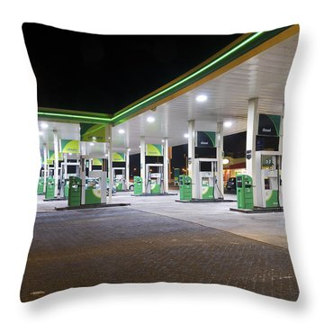 Gas Station At Night Throw Pillow by Hans Engbers