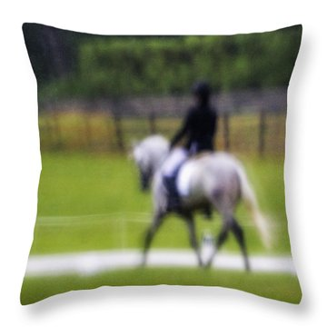 Throw Pillow featuring the photograph Rainy Day Dressage by Joan Davis