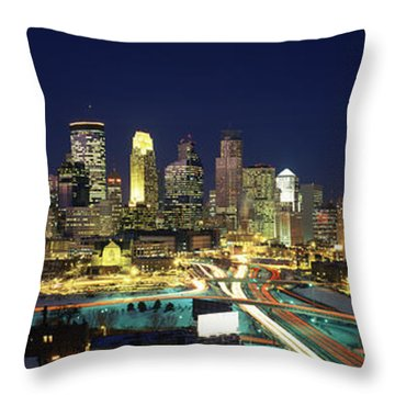 Buildings Lit Up At Night In A City Throw Pillow