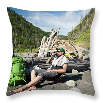 A Backpacker Relaxing With A Flask Throw Pillow
