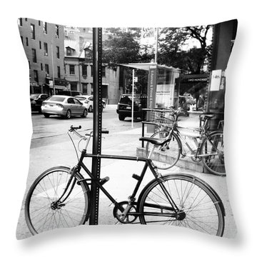 A Bike In Nyc Throw Pillow by Robin Coaker