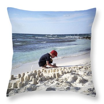 A Boy Builds A Sand Castle Throw Pillow