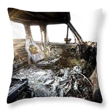 A Burned Out Truck At Sunset Throw Pillow
