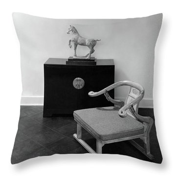 A Chair, Bedside Cabinet And Sculpture Of A Horse Throw Pillow