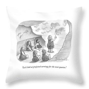 A Circle Of Cavemen Sit Around One Caveman Who Throw Pillow