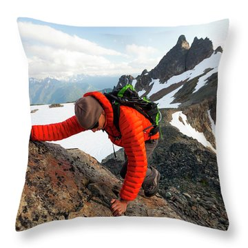 A Climber Scrambles Up A Rocky Mountain Throw Pillow