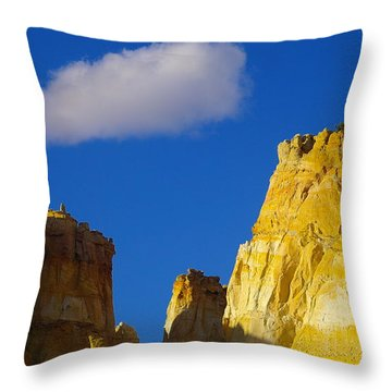 A Cloud Over Orange Rock Throw Pillow by Jeff Swan
