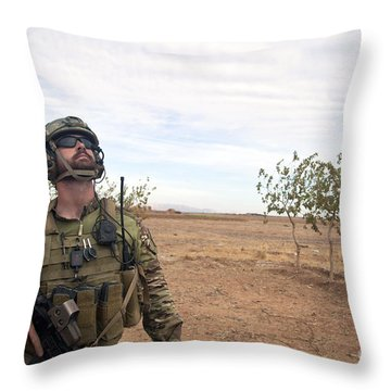 A Coalition Force Member Looks For Air Throw Pillow by Stocktrek Images
