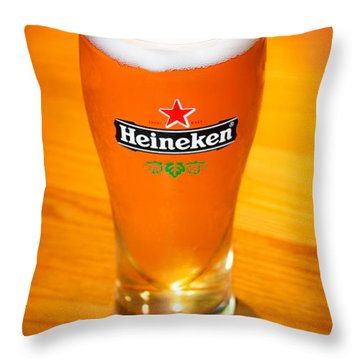 A Cold Refreshing Pint Of Heineken Lager Throw Pillow by Semmick Photo