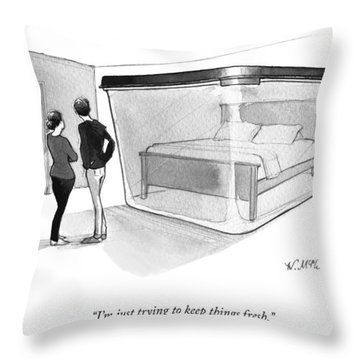 A Couple Looks At A Bed Encased In A Giant Throw Pillow