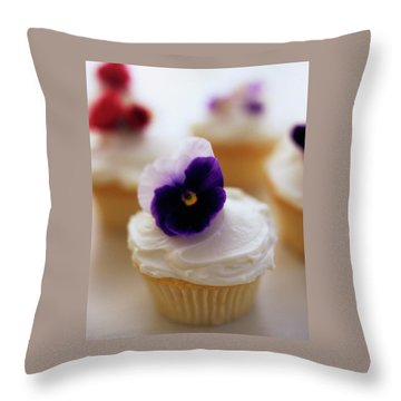 A Cupcake With A Violet On Top Throw Pillow