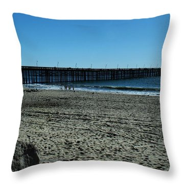 Throw Pillow featuring the photograph A Day At The Beach by Michael Gordon