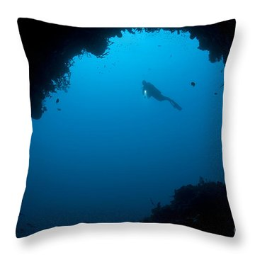 A Diver Explores A Cavern In Gorontalo Throw Pillow by Steve Jones