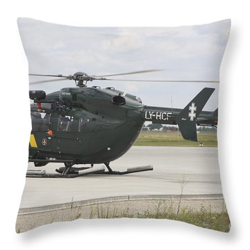 A Eurocopter Ec145 Helicopter Throw Pillow by Timm Ziegenthaler