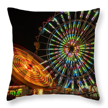 Throw Pillow featuring the photograph Colorful Carnival Ferris Wheel Ride At Night by Jerry Cowart