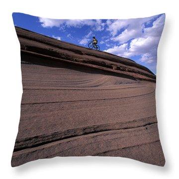 A Female Mountain Biker Mountain Biking Throw Pillow