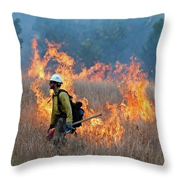 A Firefighter Ignites The Norbeck Prescribed Fire. Throw Pillow by Bill Gabbert