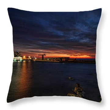 Throw Pillow featuring the photograph a flaming sunset at Tel Aviv port by Ron Shoshani