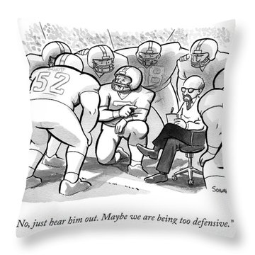 A Football Team Huddles Around A Therapist Throw Pillow