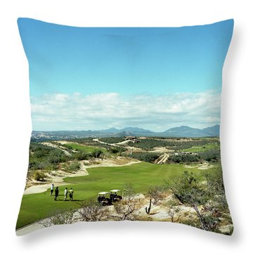 A Foursome Tees Off On A Golf Course Throw Pillow