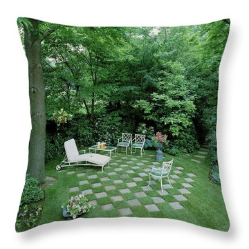 A Garden With Checkered Pavement Throw Pillow