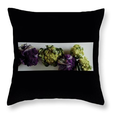A Group Of Cauliflower Heads Throw Pillow by Romulo Yanes