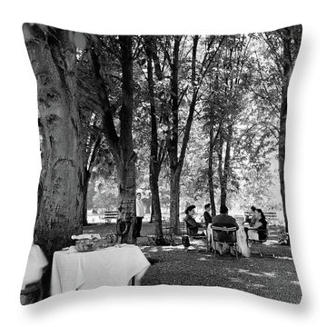 A Group Of People Eating Lunch Under Trees Throw Pillow
