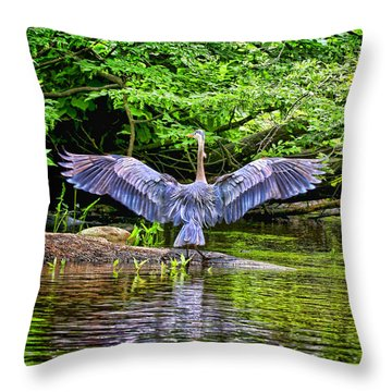 Throw Pillow featuring the photograph A Heron Touches Down by Eleanor Abramson