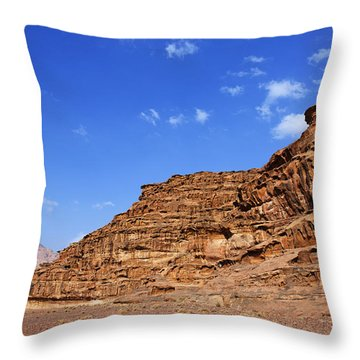 A Landscape Of Rocky Outcrops In The Desert Of Wadi Rum Jordan Throw Pillow by Robert Preston