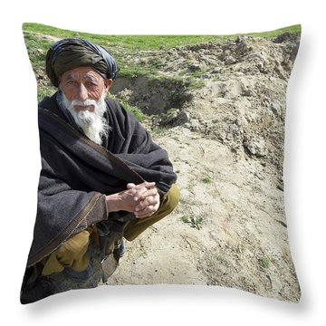 A Local Afghan Man Near A Village Throw Pillow by Stocktrek Images