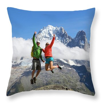 A Male And Female In Colorful Clothing Throw Pillow
