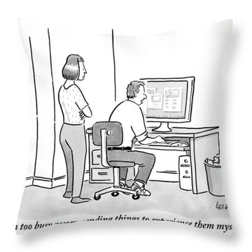 A Man Sits In Front Of His Computer. His Wife Or Throw Pillow