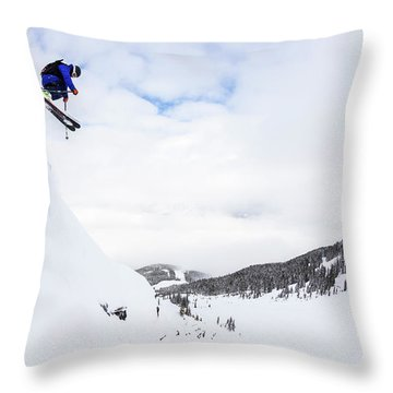 A Man Skis Deep Powder On A Stormy Day Throw Pillow