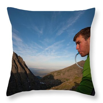 A Man Taking A Water Break On A Ridge Throw Pillow