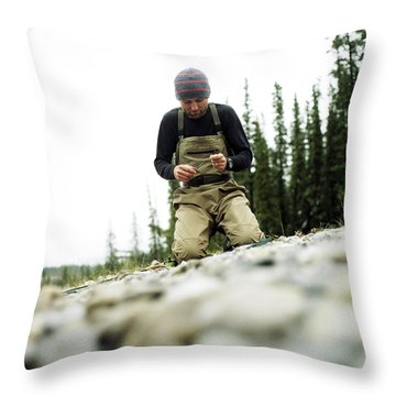 A Man Ties A Fly Beside The Bow River Throw Pillow